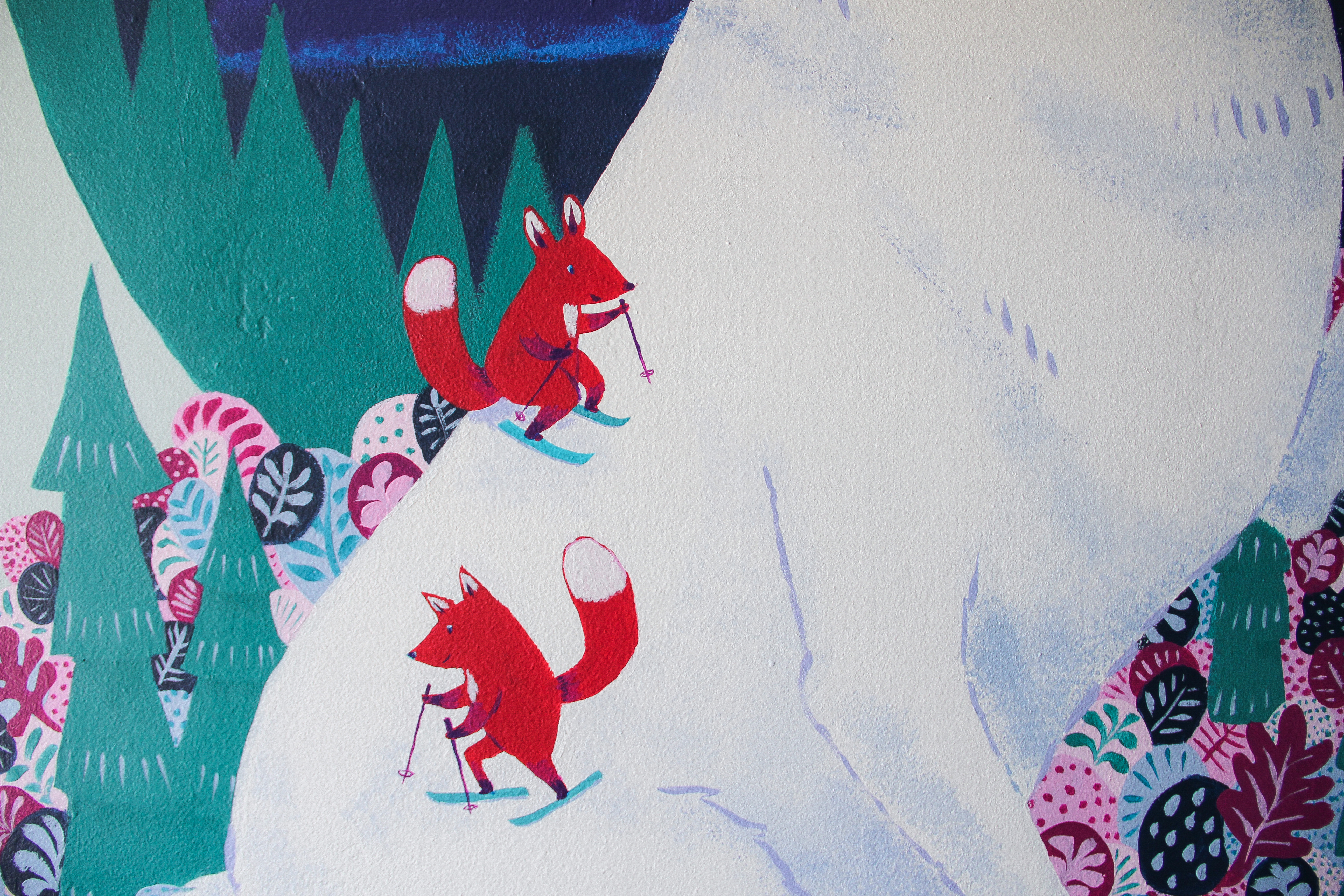 mural detail: foxes skiing down the wolf's back