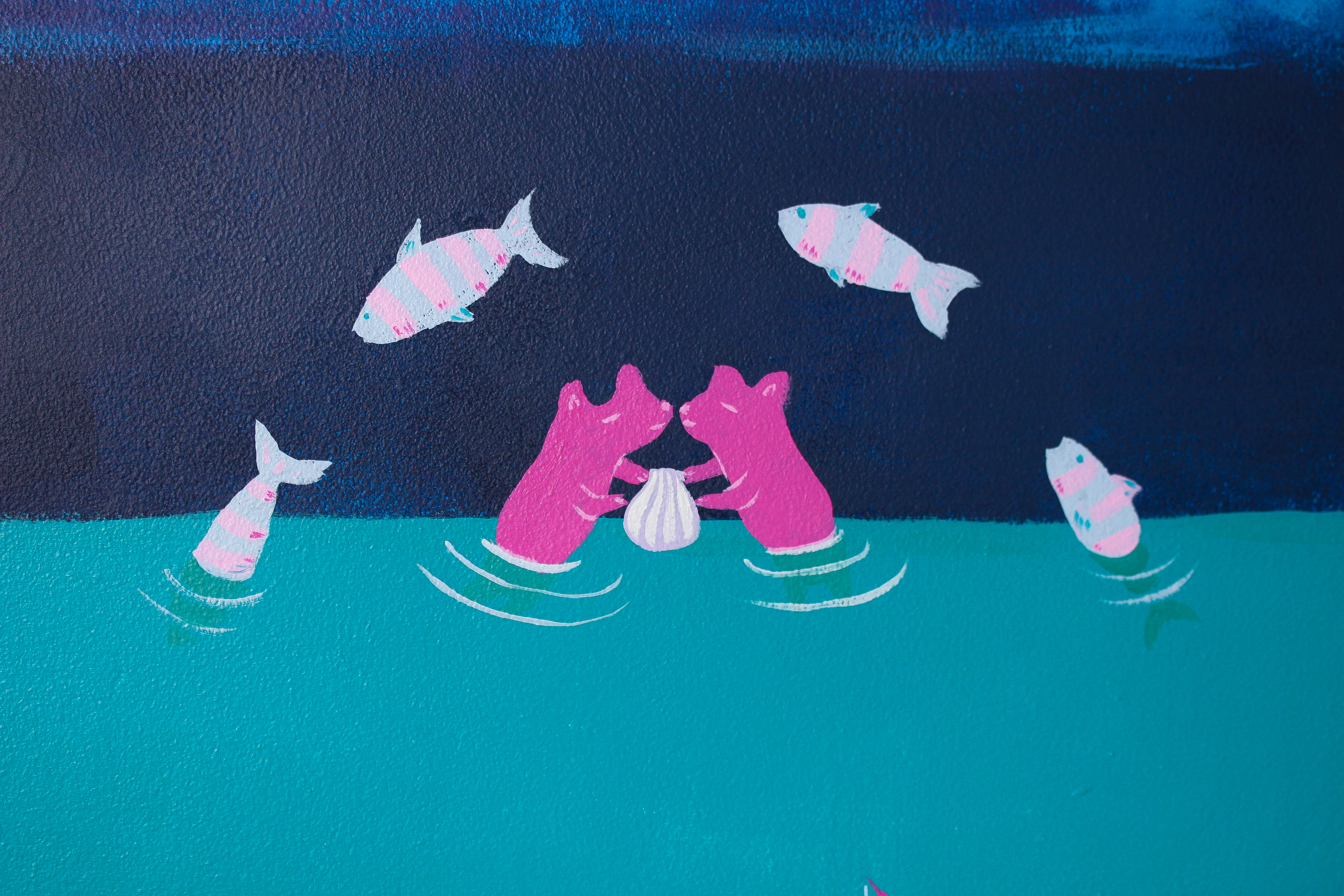 mural detail: otters sharing a clam under an arch of jumping fish